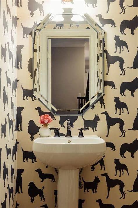 chic powder room features walls clad  madison humphrey