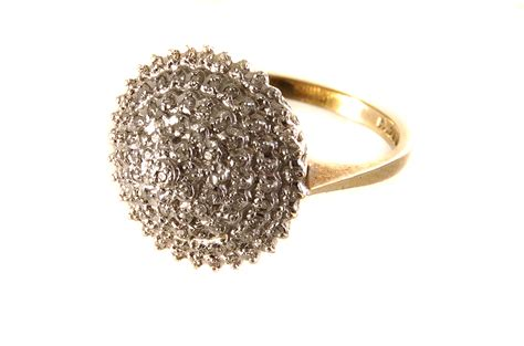 A 9ct Gold And Diamond Cluster Ring, The Large Cone Shaped. Teardrop Diamond Rings. Sunstone Wedding Rings. High Quality Wedding Rings. Collection Rings. $70000 Wedding Rings. Long Skinny Finger Wedding Rings. Raw Tourmaline Wedding Rings. Small Size Rings