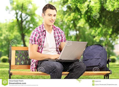 Smiling Male Student Sitting On A Bench And Working On A Ikea Klingsbo Coffee Table Decorating A Glass Made Out Of Books Parquet Modern Ottoman Wicker Rattan Tables Trunk Walnut