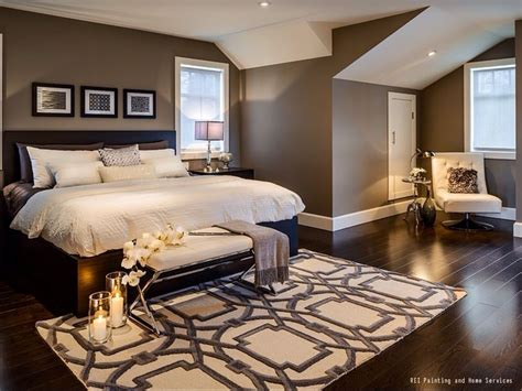 a warm and cozy bedroom with hardwood floors and