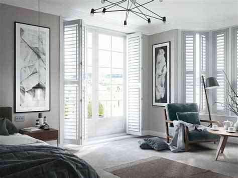bedroom  white full length shutters shutters