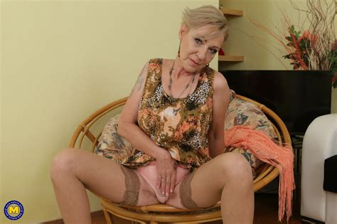 horny granny spreads her legs to masturbated her hot old pussy and finger