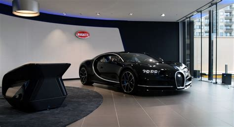 Iconic logos like the bugatti macaron, reproduced especially for the 110th anniversary, and drawings relating the history of bugatti through its most iconic cars make this capsule collection truly. Inside the largest Bugatti showroom in Europe