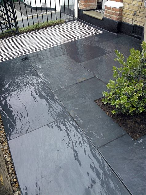 mosaic tile path with slate paving and