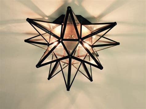 glass moravian star wall sconce custom metal lighting