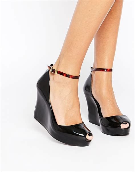lyst melissa patchuli peep toe wedge shoes  black