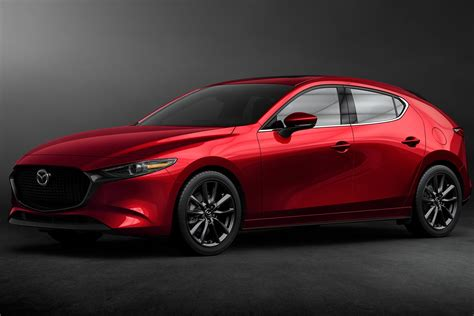 los angeles auto show  mazda  hatch  sedan revealed