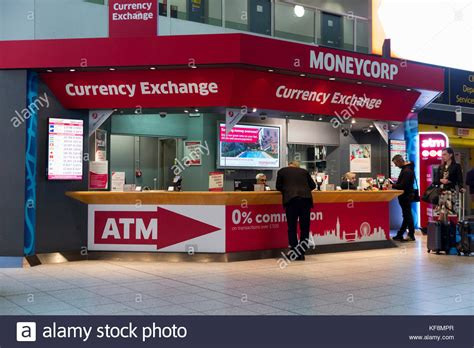 the shop bureau de change airport atm stock photos airport atm stock images alamy