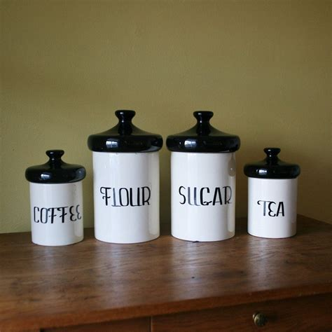vintage black and white ceramic canister set