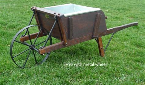 fashioned reproduction wood  metal spoke wheelbarrows