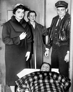 Jacqueline Kennedy standing over her husband, John F ...