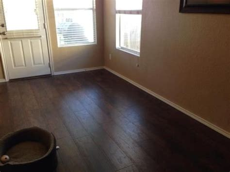 trafficmaster glueless laminate flooring saratoga hickory 49 best images about flooring on beaumont