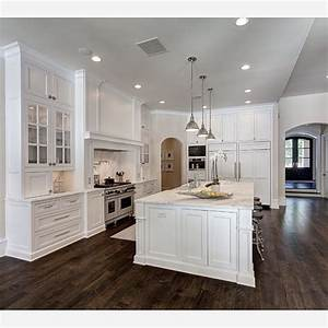 the dark hardwood floors and white cabinets create a beautiful balance in 2198