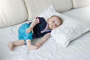 cute 1 year old baby boy relaxing on big pillow stock With best pillow for 1 year old