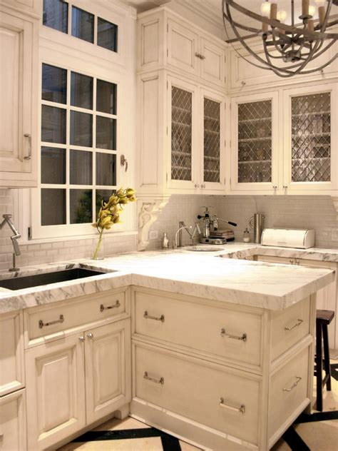 white kitchen  scroll molding accents  wire