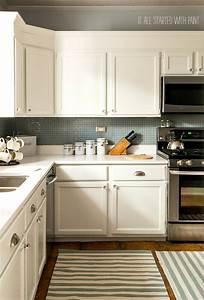 white kitchen cabinets white counter top blue gray backsplash 976