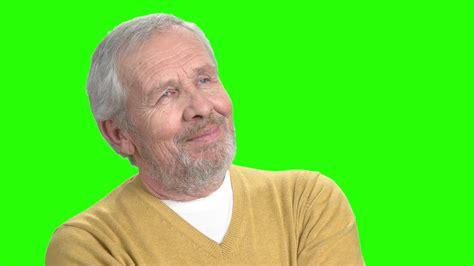 Positive thinking man, green screen. Cheerful senior man ...