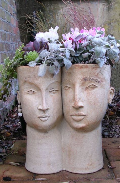 face sculpture planters   trendy  darling