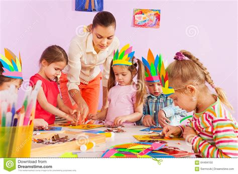 teacher teach preschool kids  art class stock photo