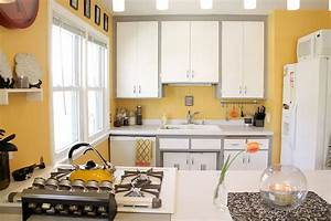 11 trendy ideas that bring gray and yellow to the kitchen With kitchen colors with white cabinets with animal head wall art