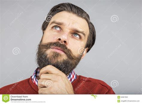 Closeup Of A Frowning Man With Frozen Beard Wearing Santa