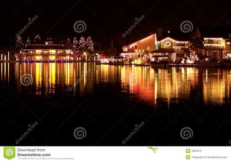 christmas lights reflecting on lake stock photography