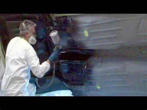 rubberized paint applying ultra tough underbody protector on a