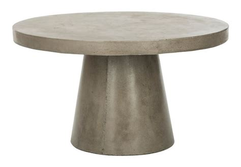 Round patio coffee tables pair especially well with sectional sofas or furniture styled in a circle around the table that mirrors its shape. Delfia Modern Concrete Round Coffee Table - Safavieh - $362 - domino.com | Concrete coffee table ...
