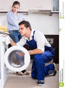 Repairman And Woman Near Washing Machine Stock Image ...