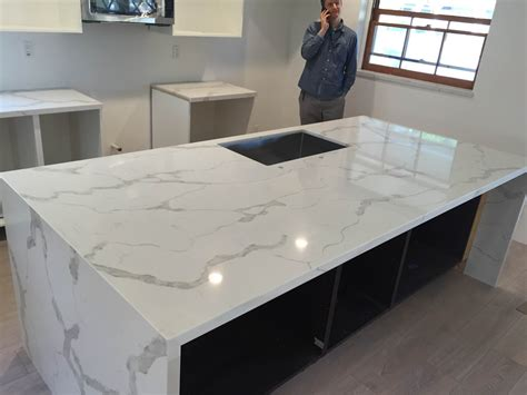 kitchen islands that look like furniture calacatta gold quartz countertop mitered edeg and island