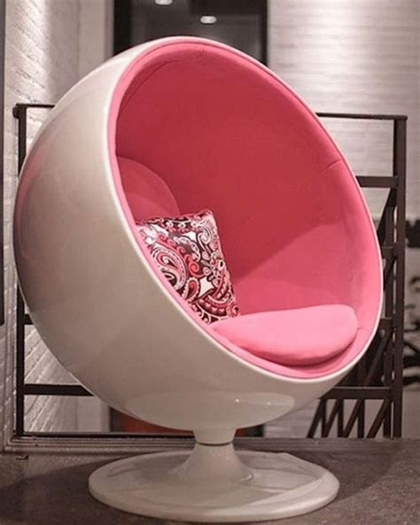 white and pink egg swivel chair pins