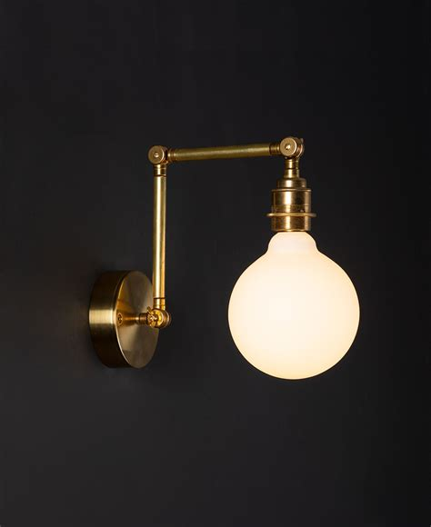 fender wall light available in polished brass or antique