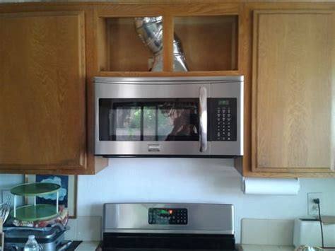 over the range microwave cabinet raised upper cabinet 7 inches to accommodate over the