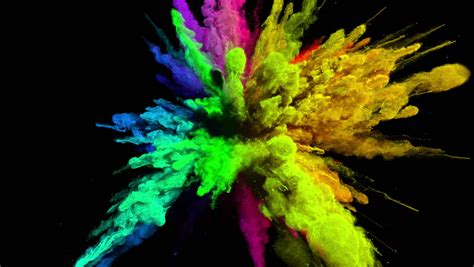 explosion of colors cg animation of color powder explosion on black background