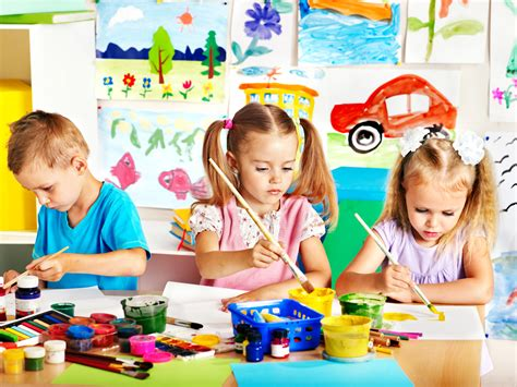 nanny vs daycare rockmybaby nanny amp household staff 719 | bigstock child painting at easel in sch 49701068