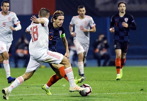Real madrid could face manchester city, inter or bayern munich in champions league group stage, but not psg; Real Madrid midfielders Dani Ceballos and Luka Modric clash during international match