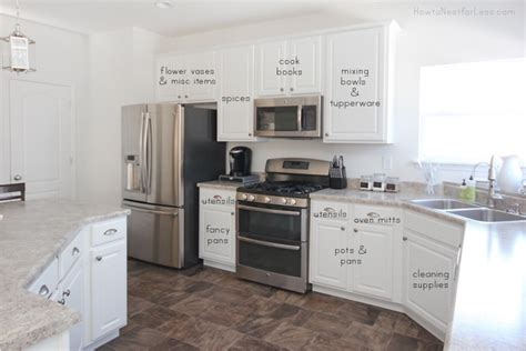 how should kitchen cabinets be organized kitchen cabinet organization how to nest for less 8484