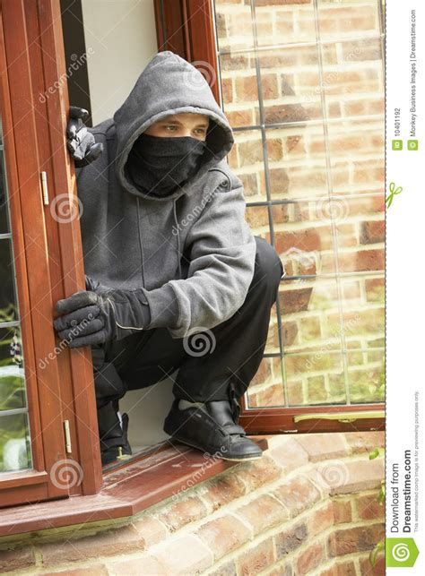 Young Man Breaking Into House Stock Photo  Image Of