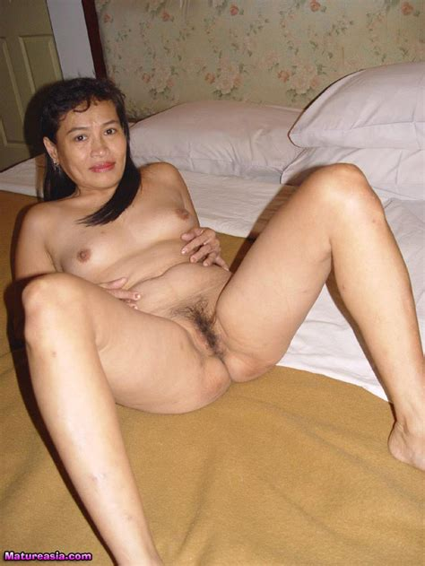 amateur asian granny with nice tits spreads her pussy and