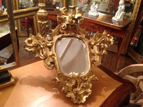 paire de petits miroirs bois sculpte  dore xviii