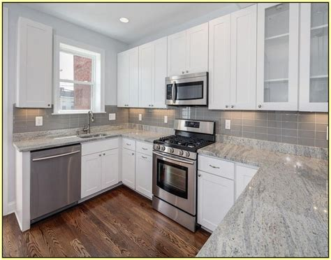 white kitchen cabinets with granite countertops white kitchen cabinets with gray granite countertops