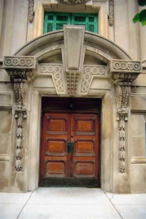 carved stone arch door   double wooden  panel doors door  window