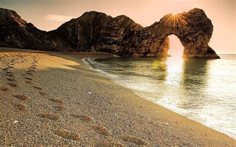footsteps   sand durdle door man  war beach