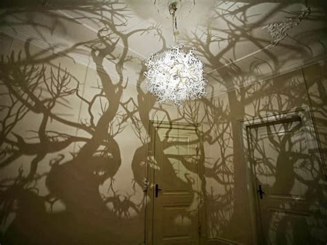 chandelier turns a room into a forest great idea idea