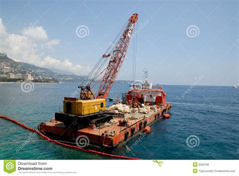 Boat Crane by Cargo Boat With Crane Royalty Free Stock Photos Image