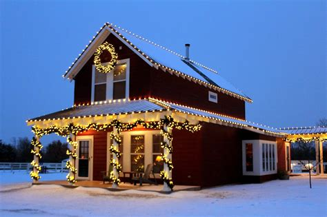 christmas houses in snow lights in snow