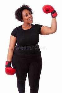 Overweight Young Black Woman Holding Boxing Gloves ...