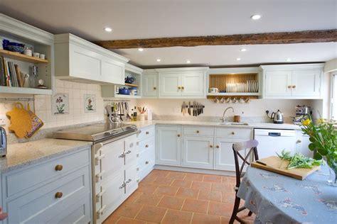 terracotta floor tile kitchen farmhouse  painted cabinets pale blue kitchen elegant