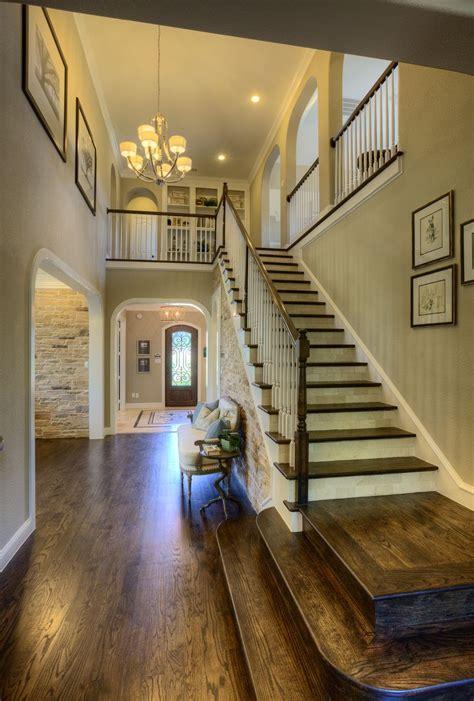 stunning modern open floor plan  cascading staircase