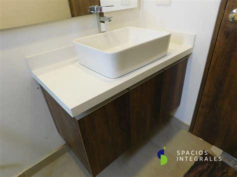 muebles  bano en madera meson en granito dekton